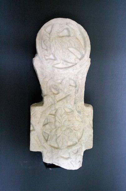 Top shaft of cross with eagle holding a book. Marble, c. 10th - 12th century.