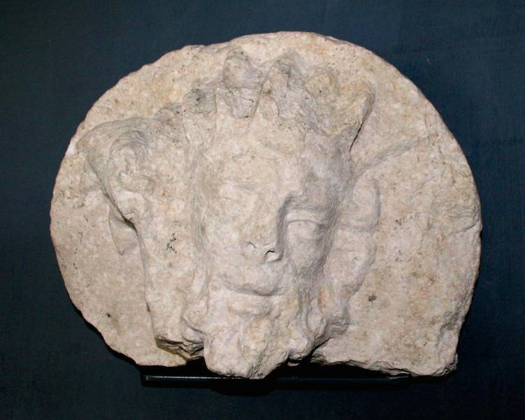 Section of roundel with male bearded head. High relief travertine, c. 16th century.