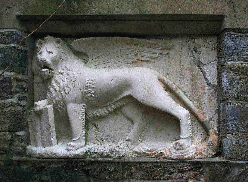High relief carving of St Mark as a winged lion. Marble.